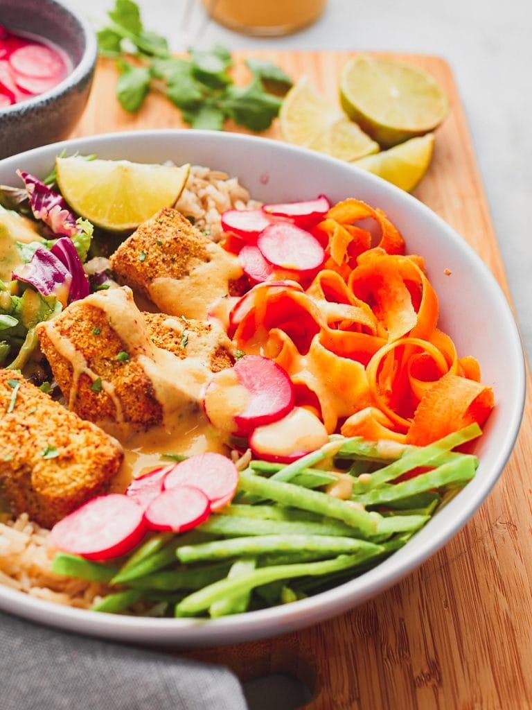 Close up of vegetables in tofu katsu salad bowl