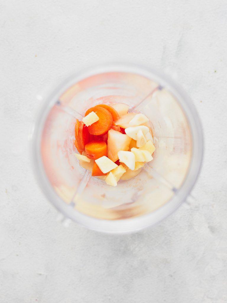 Carrots, apple and garlic in bullet blender