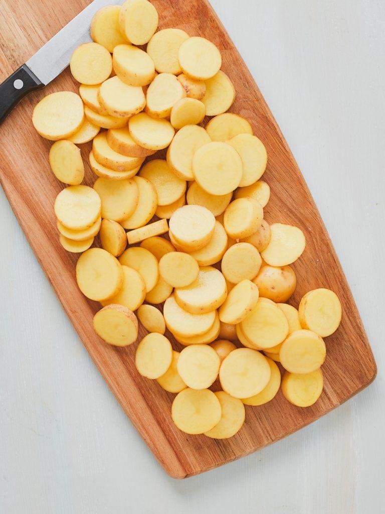 Sliced potatoes on a board