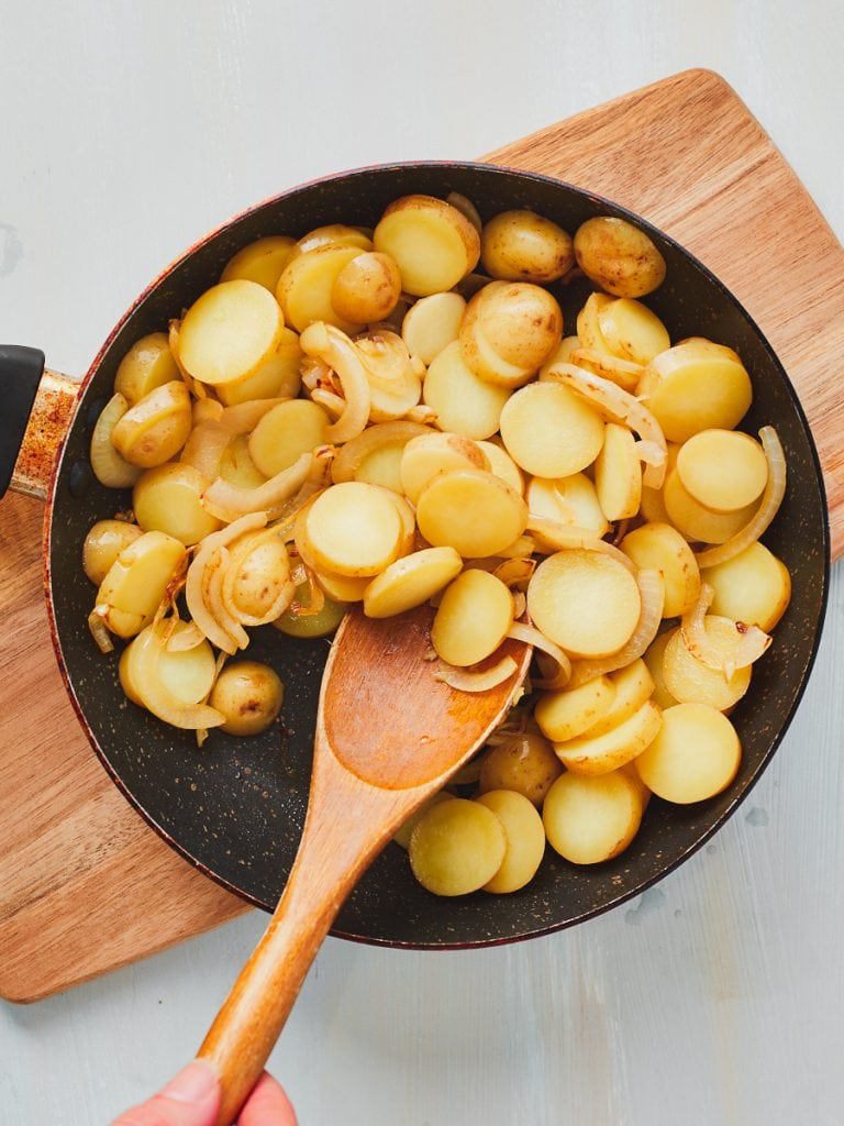 Stirring together the potatoes and onion