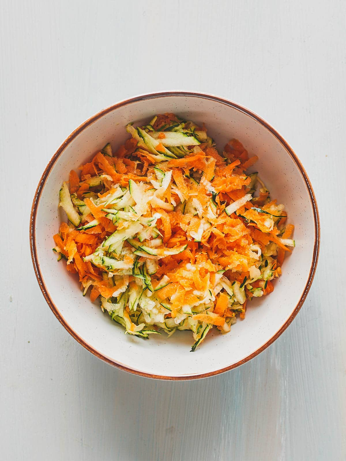 A bowl of grated carrot and zucchini