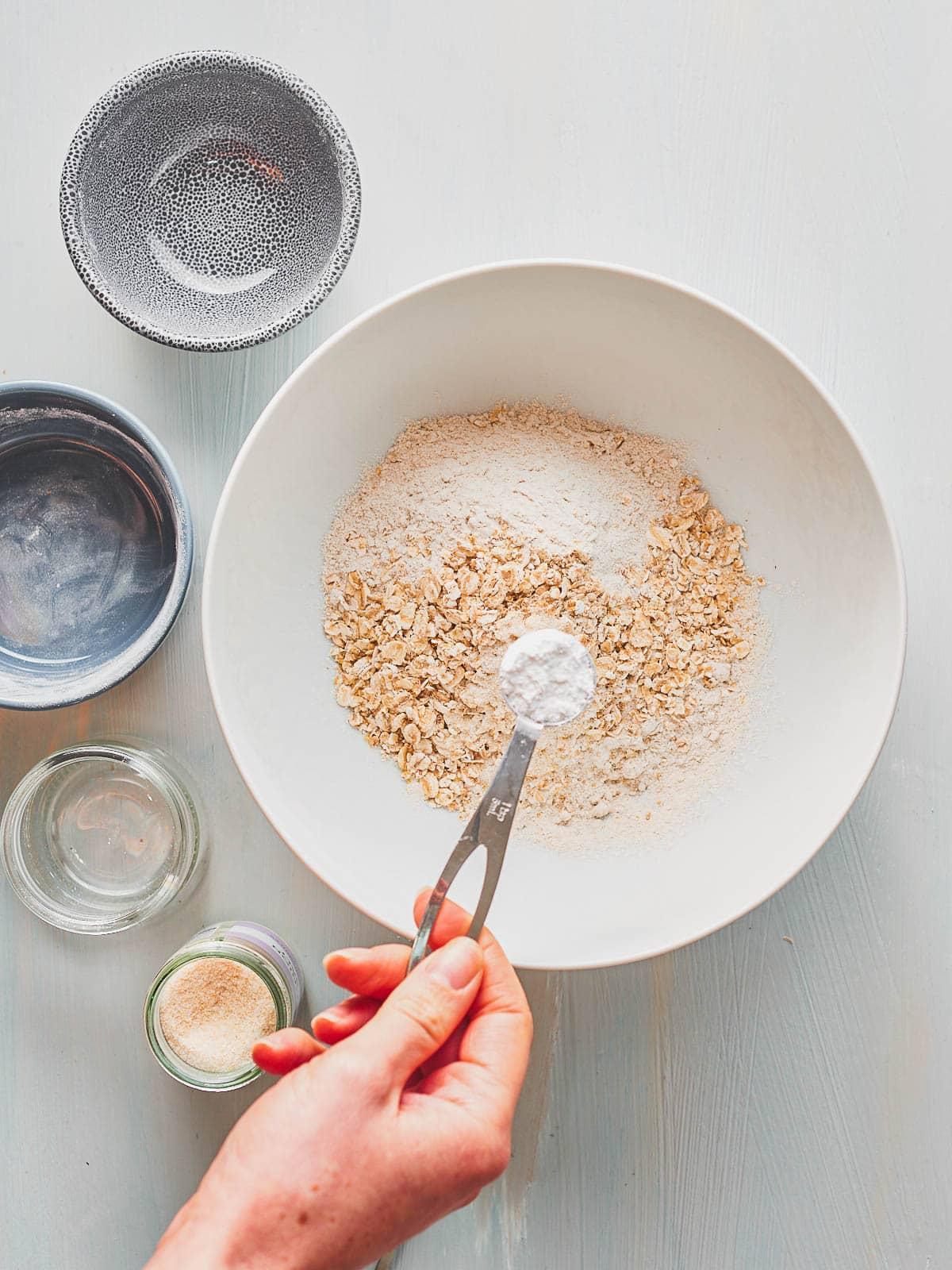 Adding baking powder to mixing bowl
