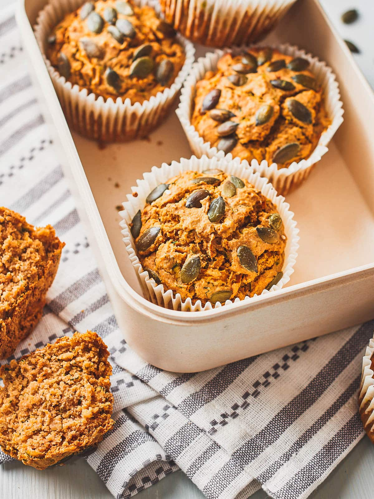 Box of vegan savoury muffins with one cut in half on the side