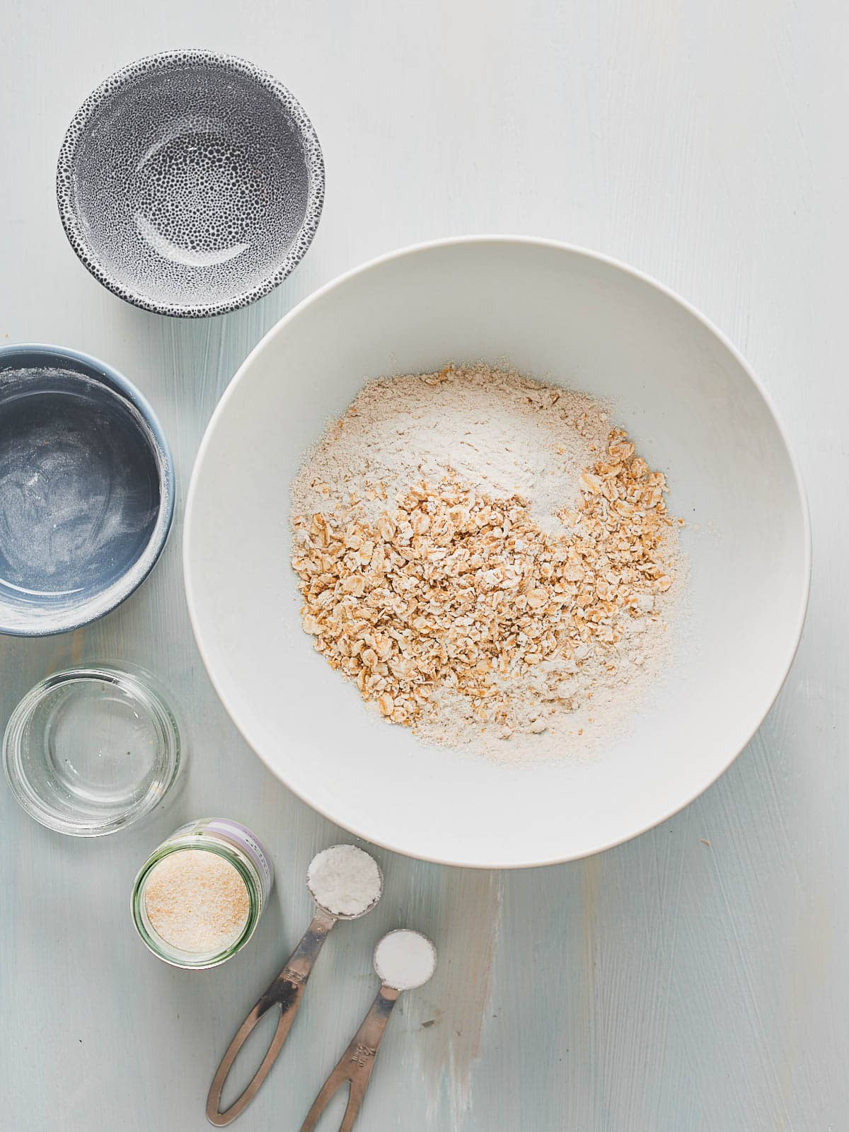 Buckwheat flour, oat flour and oats added to mixing bowl