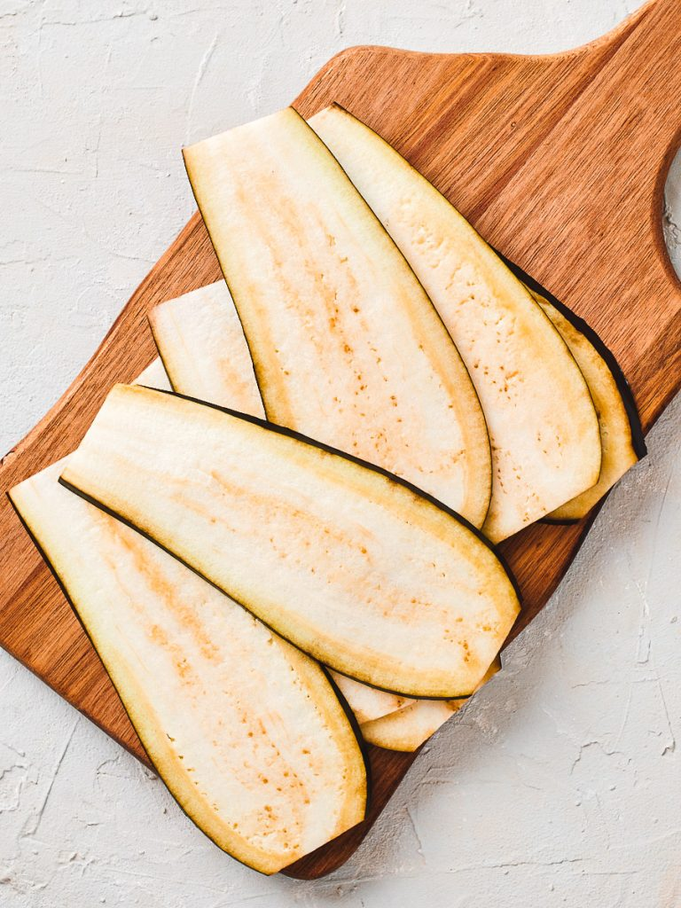 Thin slices of eggplant on a board