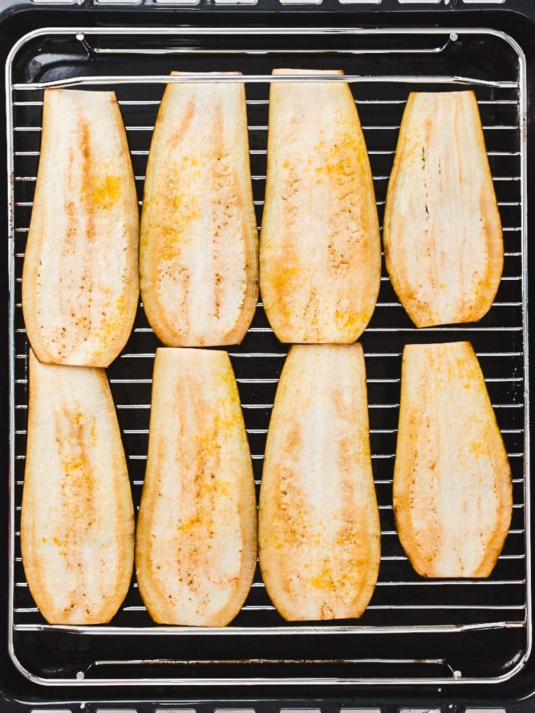 Eggplant slices lined up on grill pan
