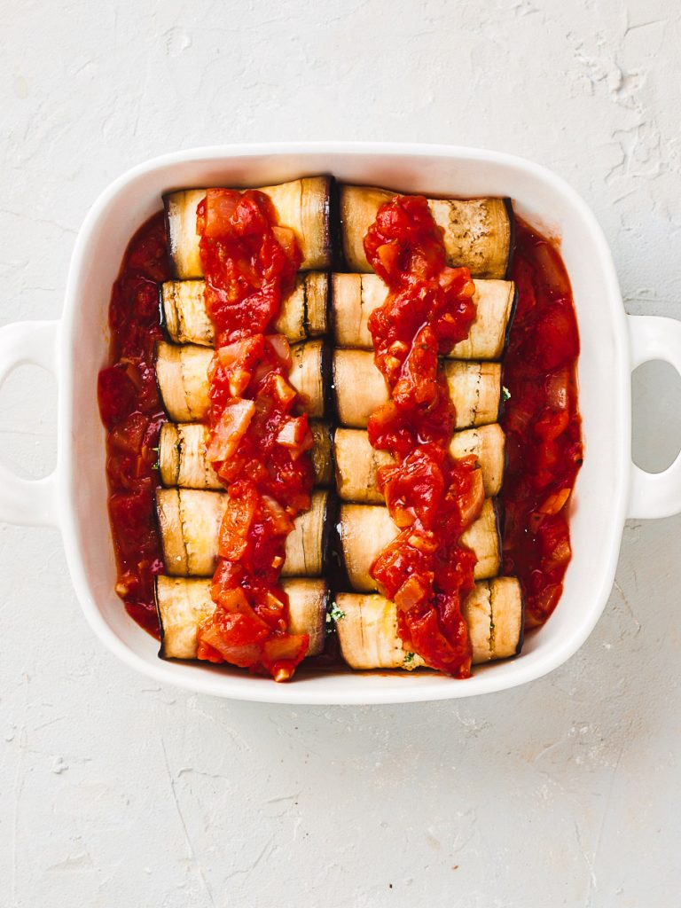 Eggplant cannelloni with tomato sauce on top