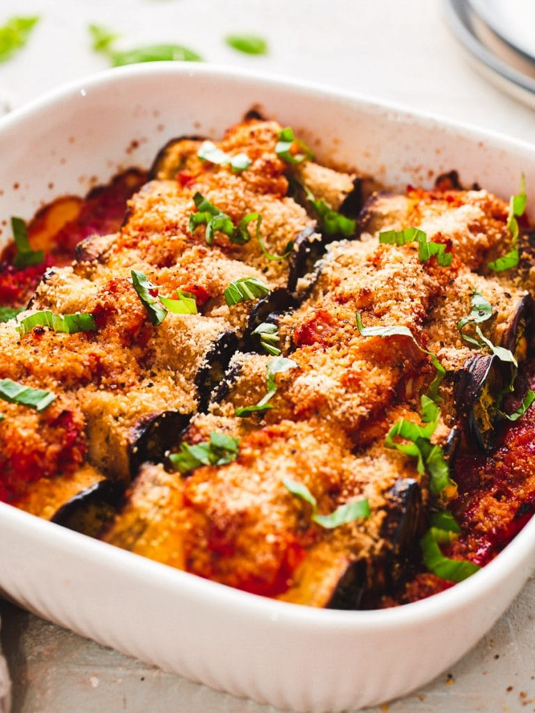 Dish with vegan cannelloni baked, topped with basil