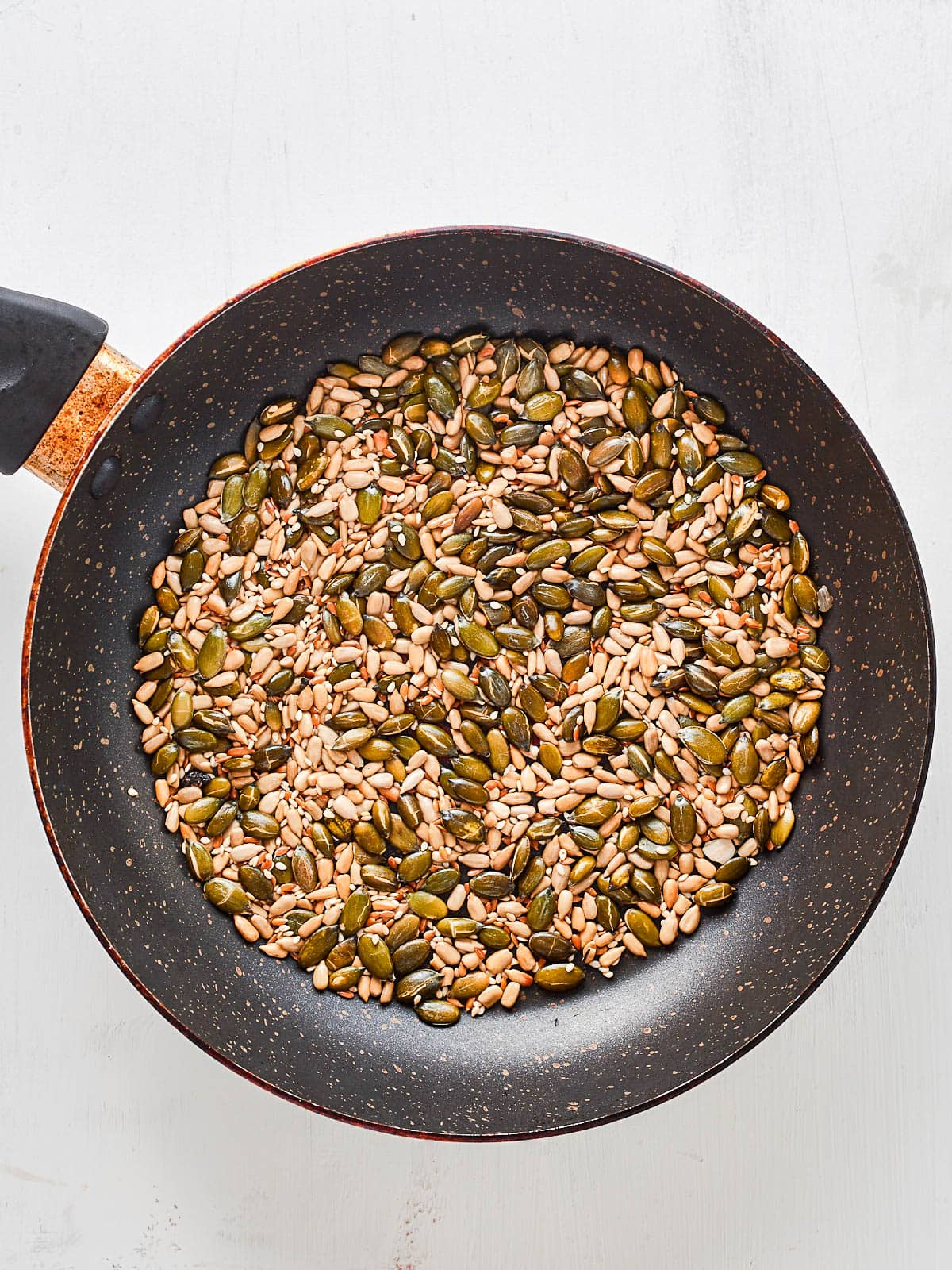 Toasting seeds in a frying pan