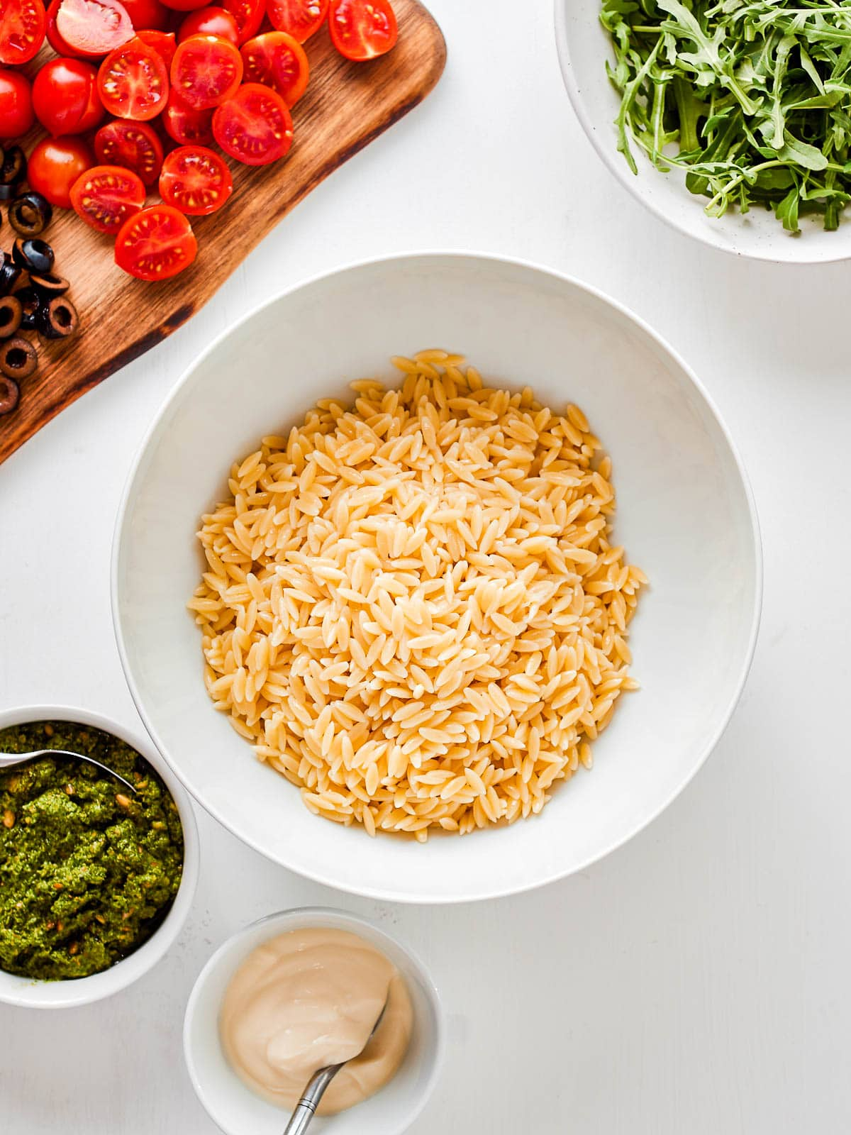Orzo in mixing bowl