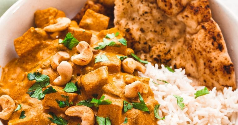 Vegan shahi korma in a bowl with rice and naan
