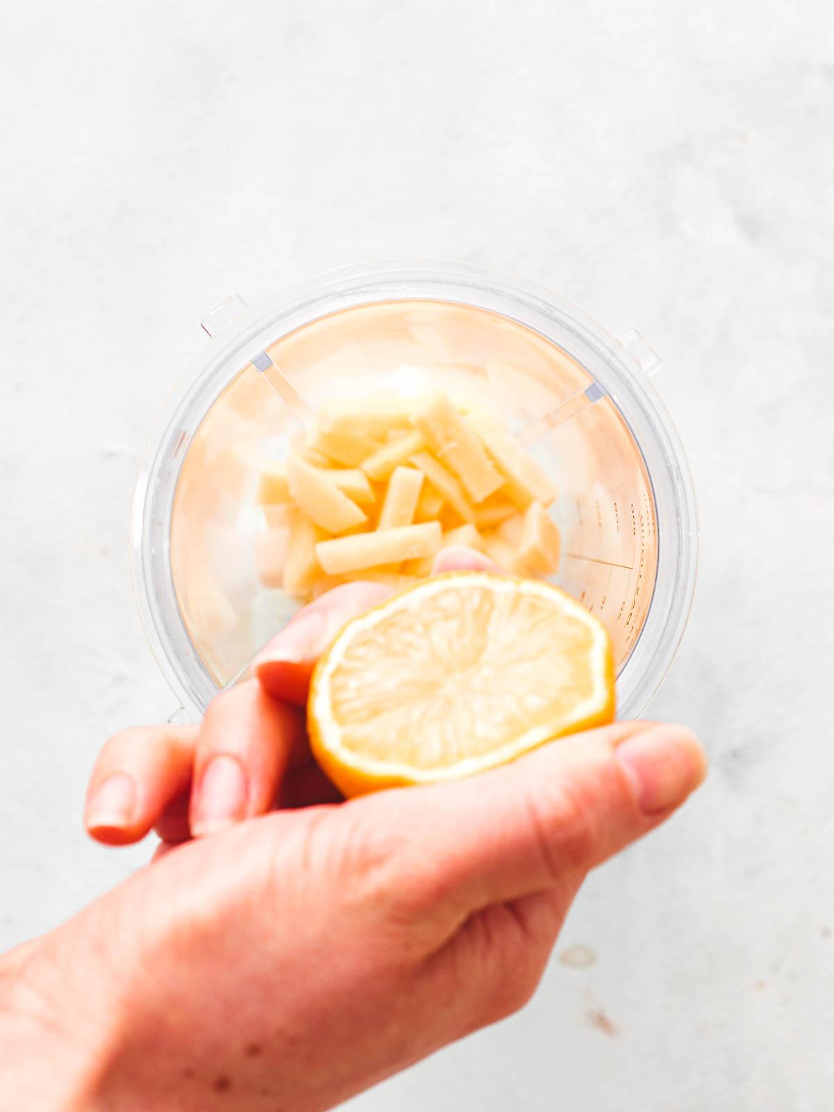 Adding the lemon to the blender