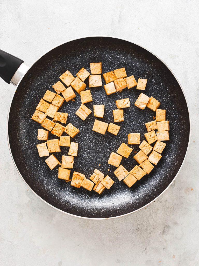 Browned off tofu in frying pan