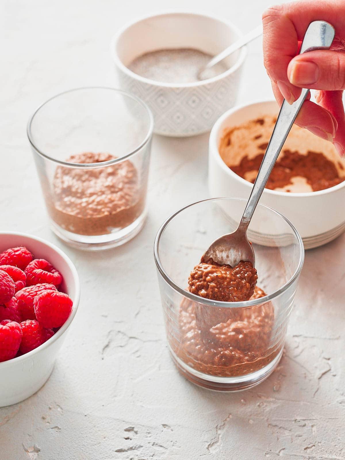 Adding chocolate chia pudding to the glass