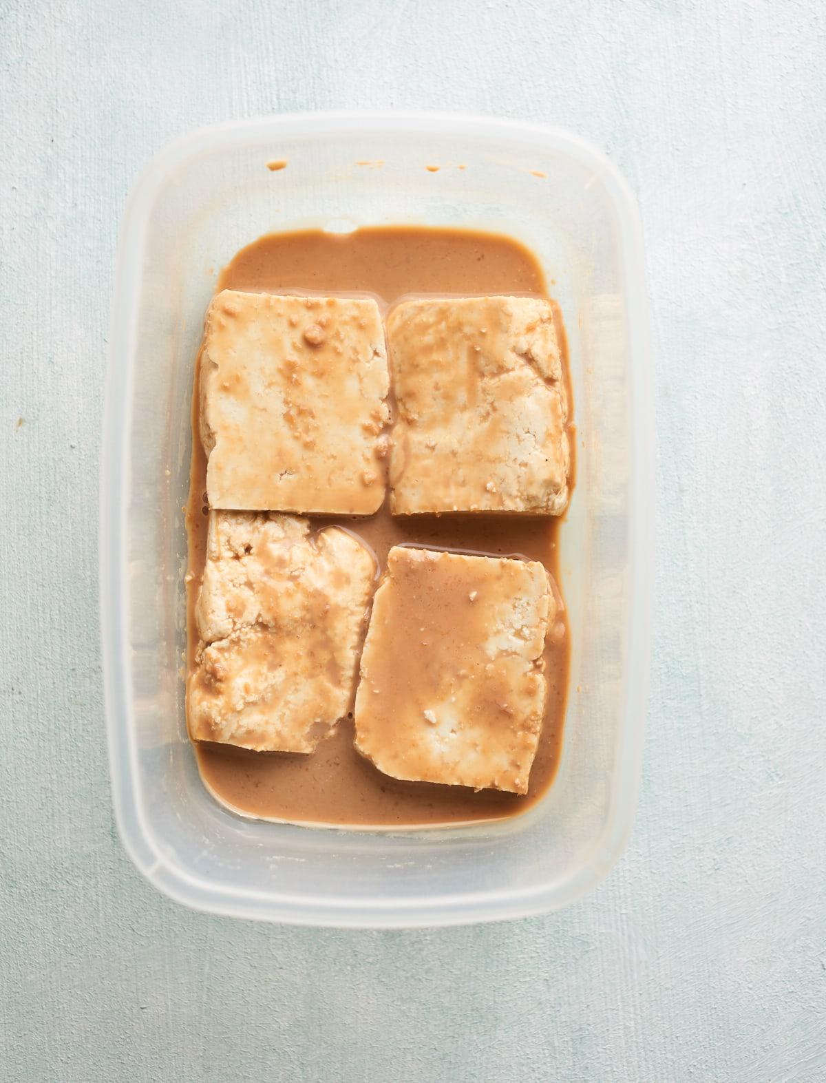 Tofu marinating in spiced coconut yoghurt