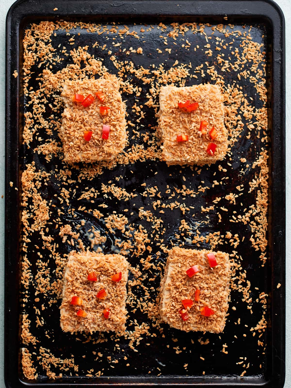 Coconut tofu on baking sheet ready to go in the oven