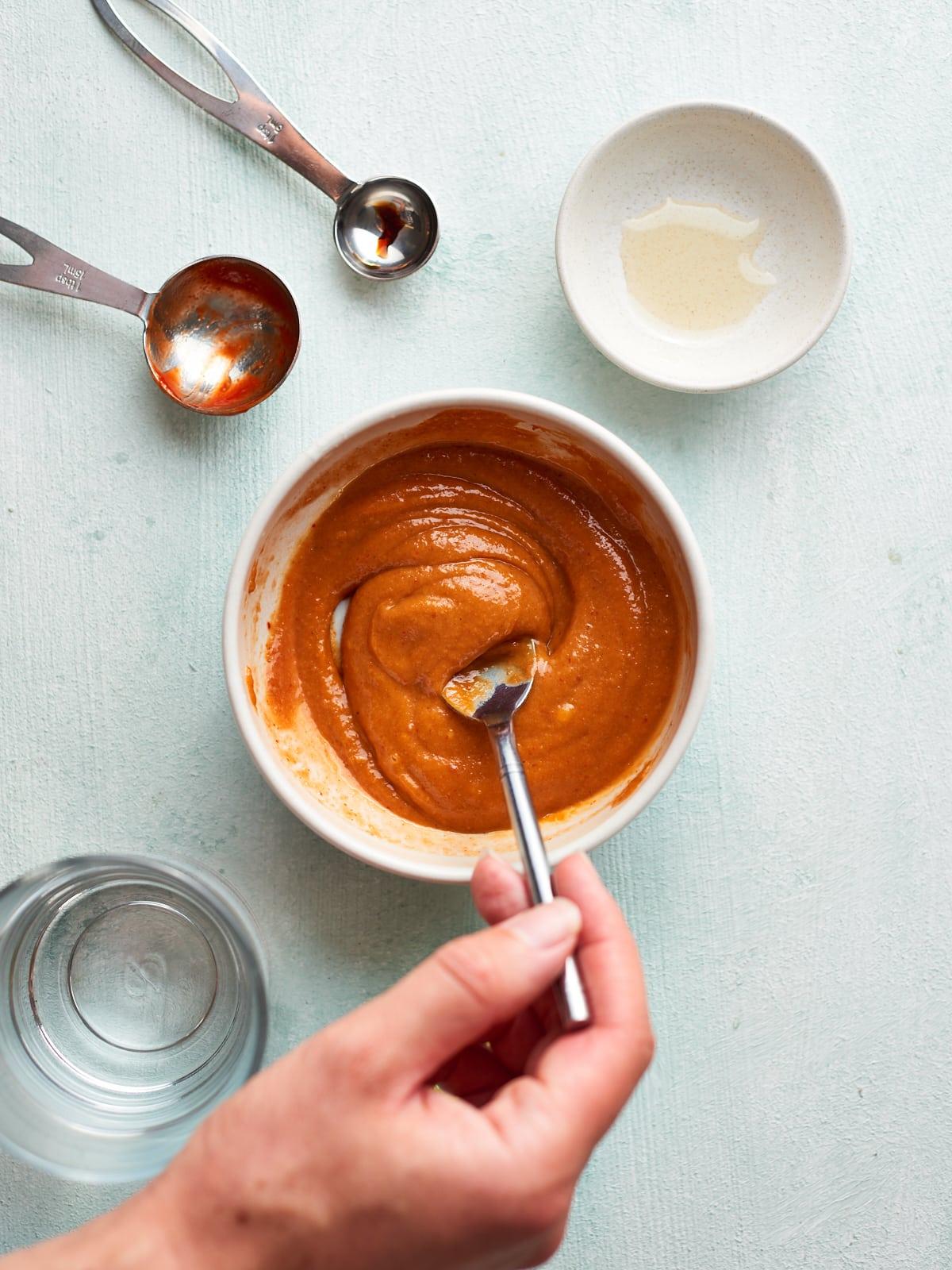 Stirring the tahini sauce