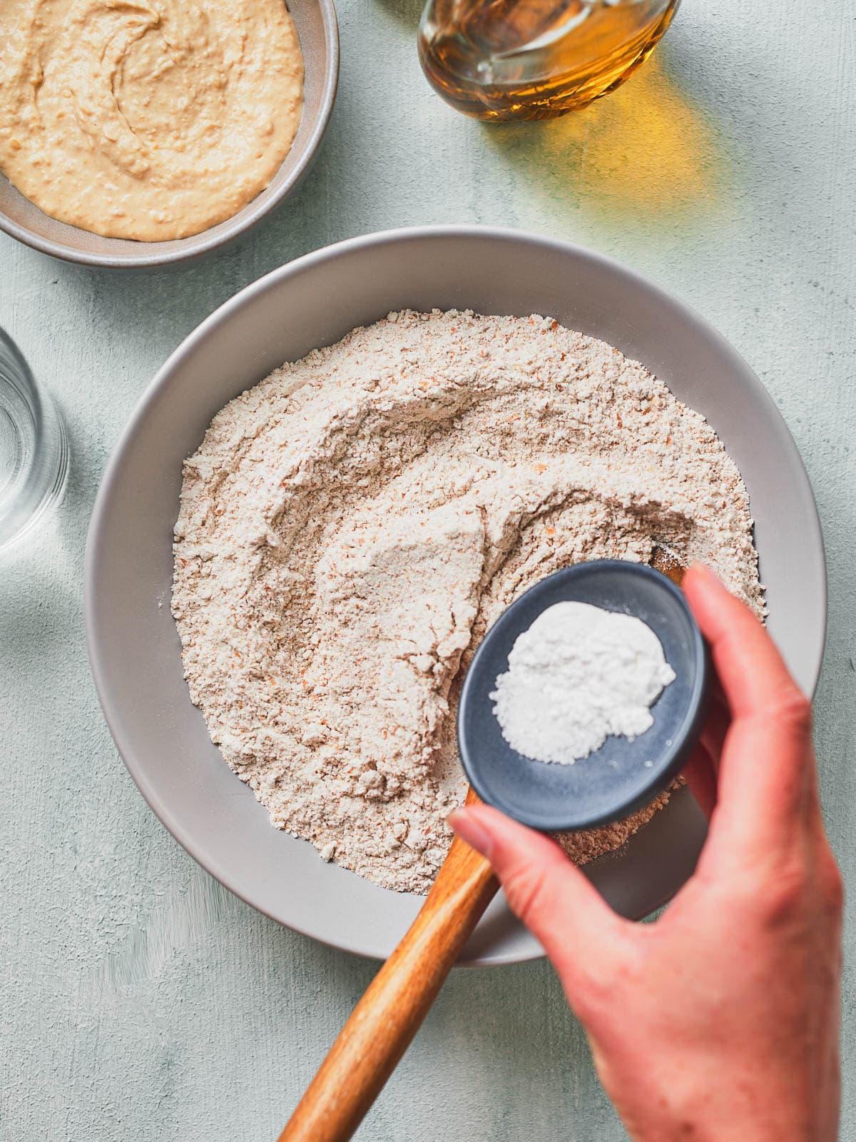 Adding baking powder and salt to the flour