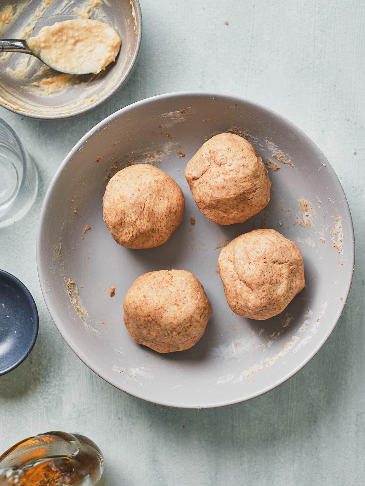 Dough split into four balls