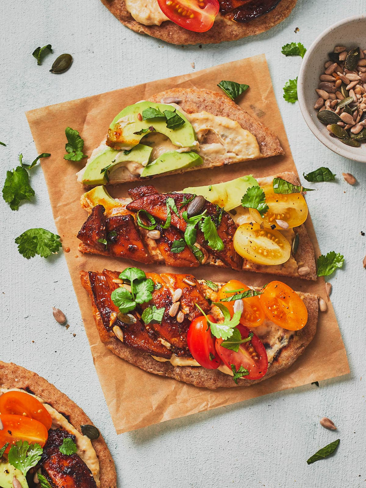 Overhead photo of one hummus flatbread on baking paper