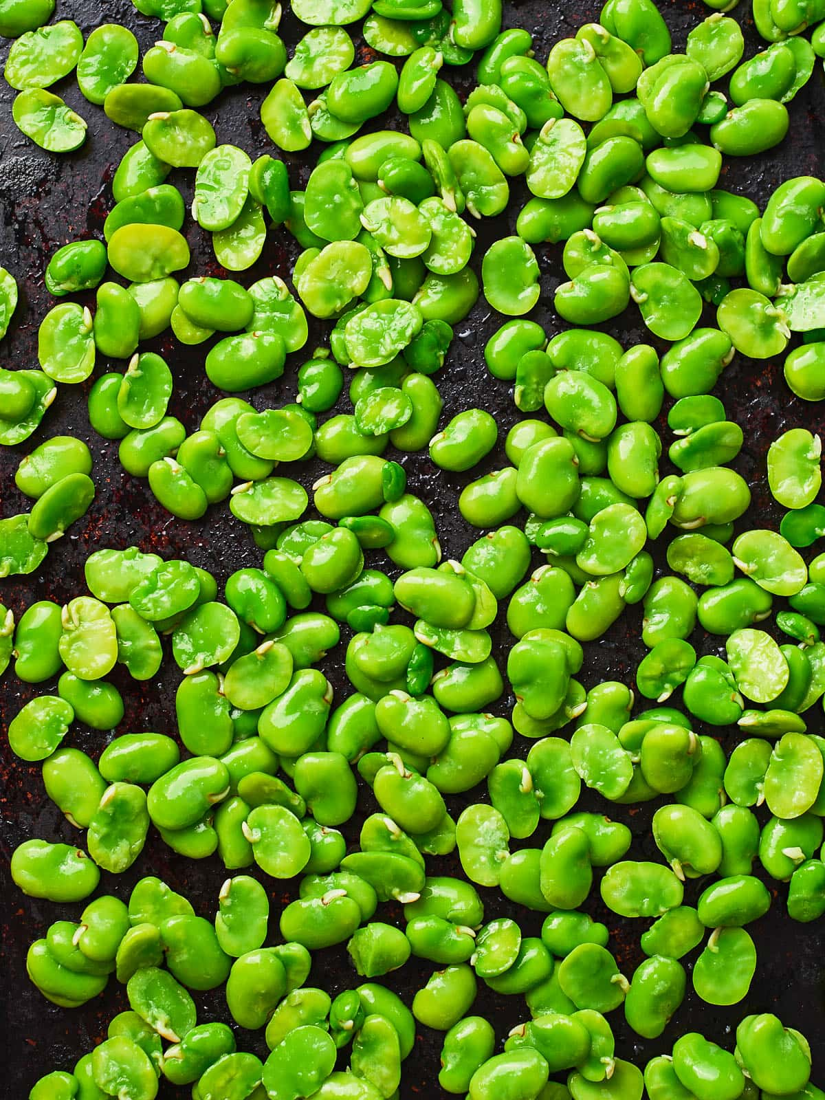 Broad beans on a baking tray