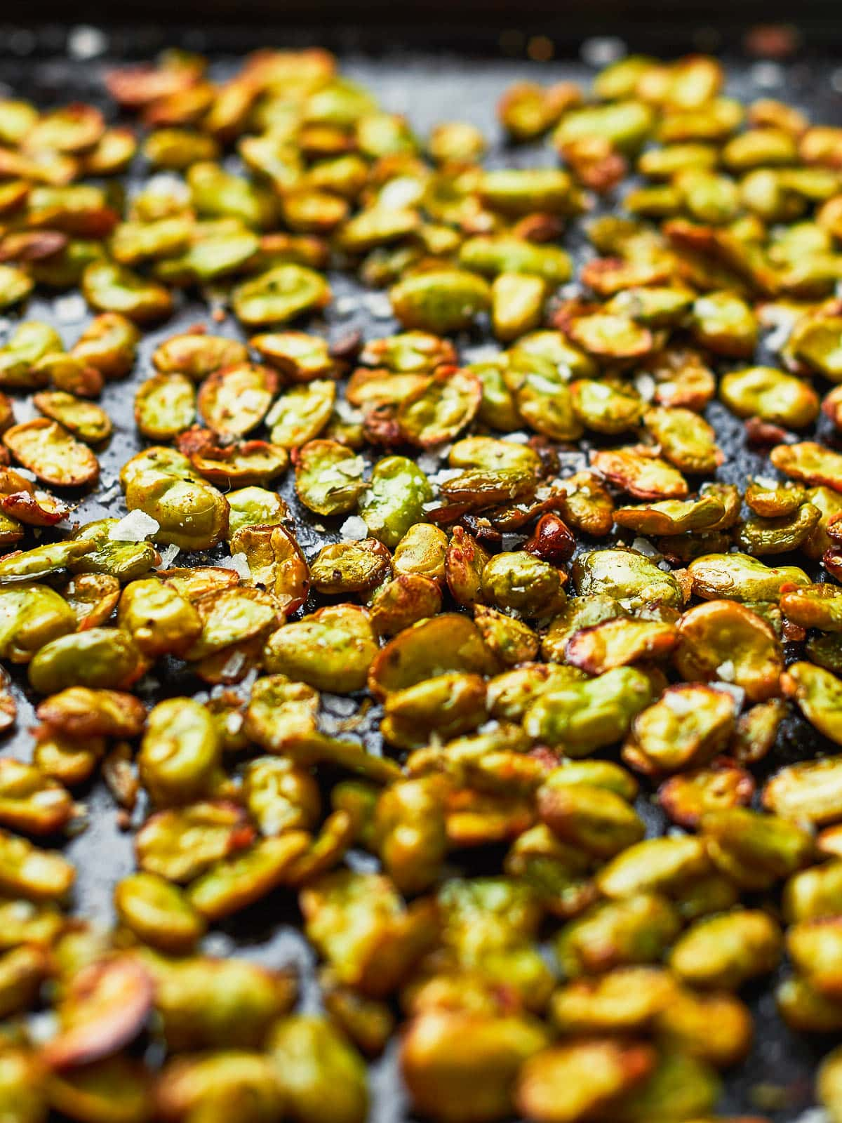 Roasted broad beans on a baking tray