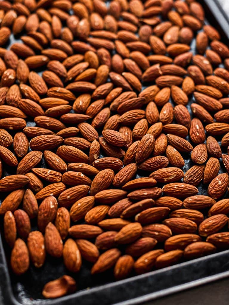 Almonds on a baking sheet after roasting