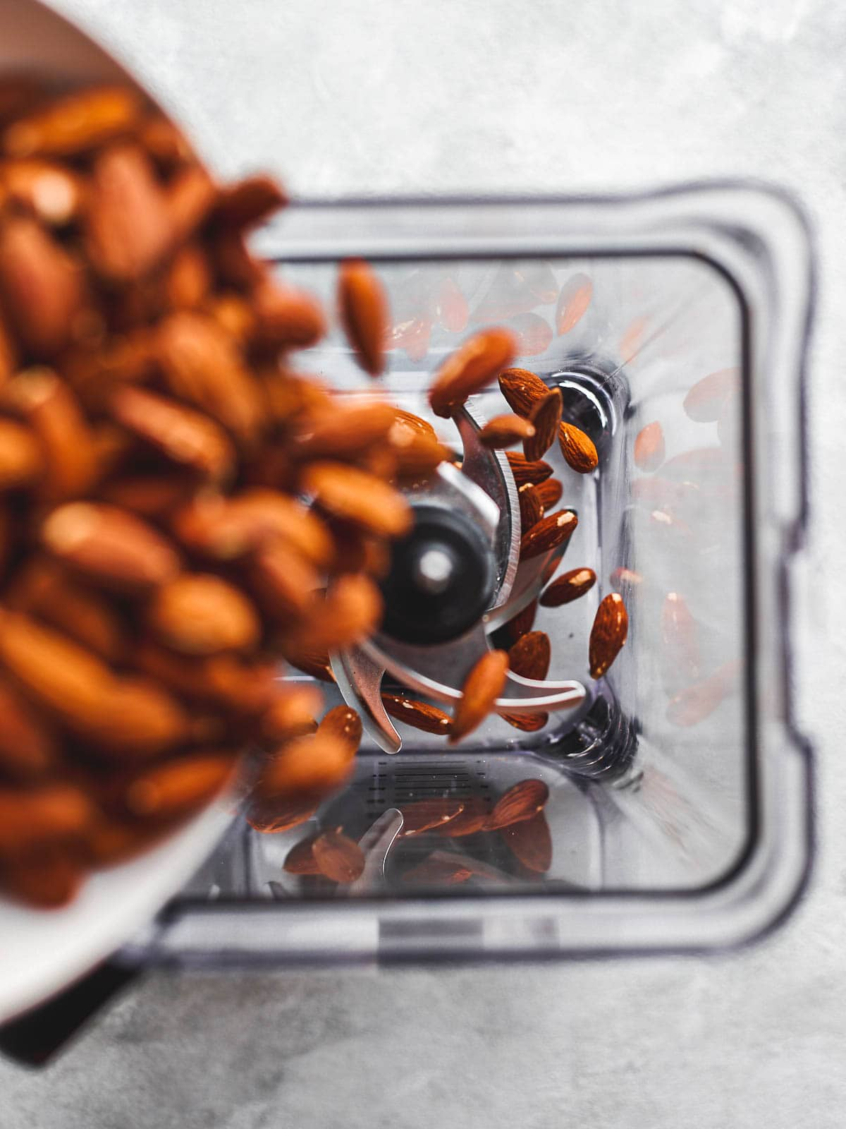 Pouring almonds into blender