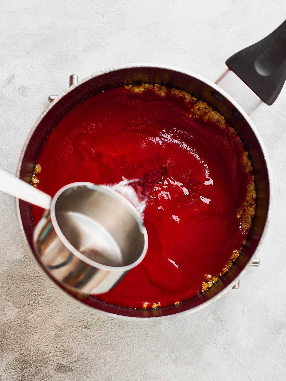Adding water to thin enchilada sauce