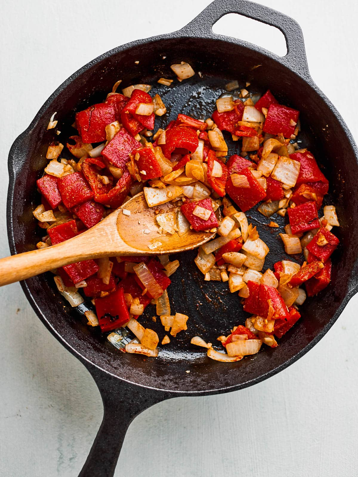 Frying off the spices, onion and pepper