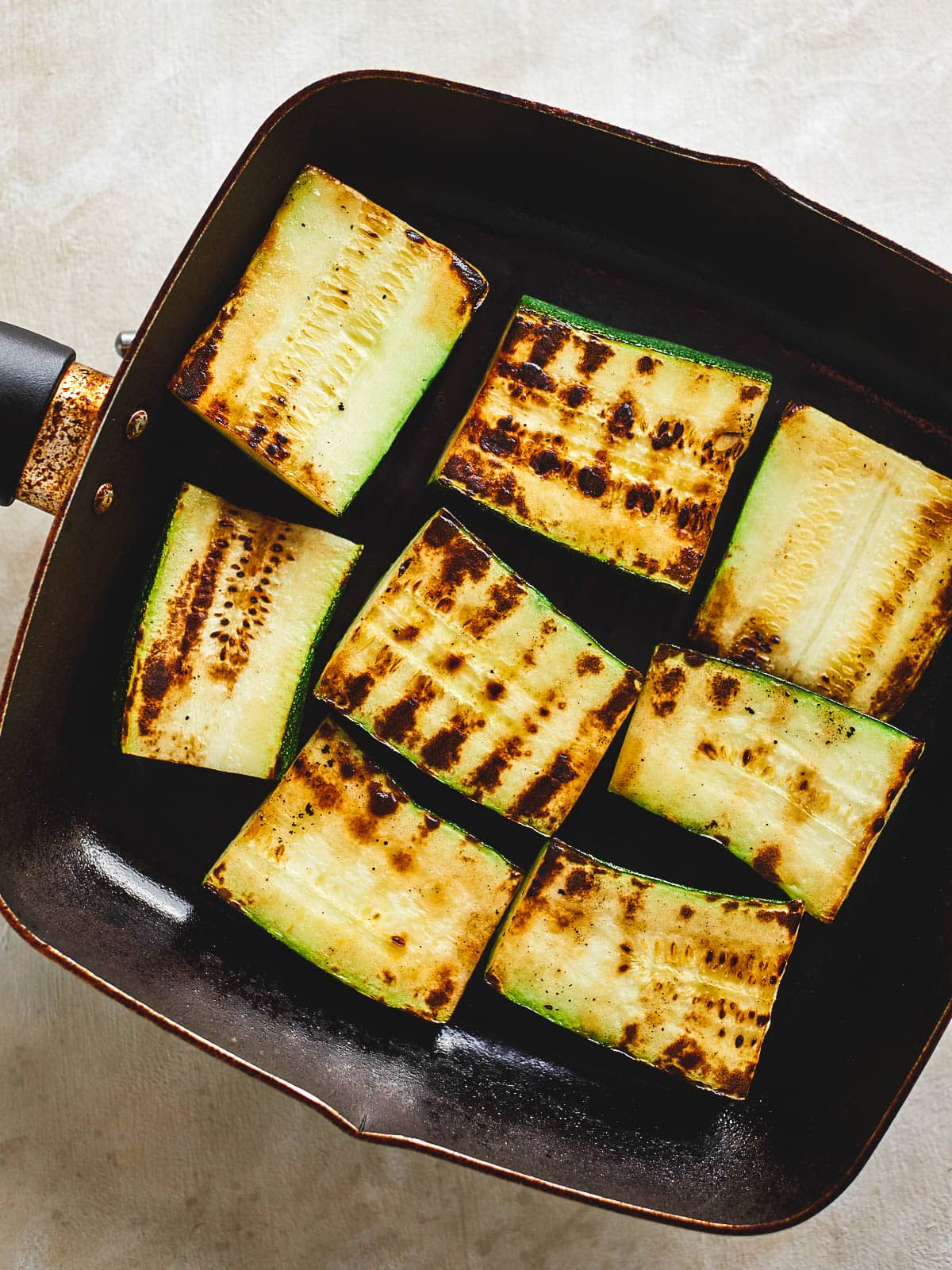 Zucchini grilling in a pan