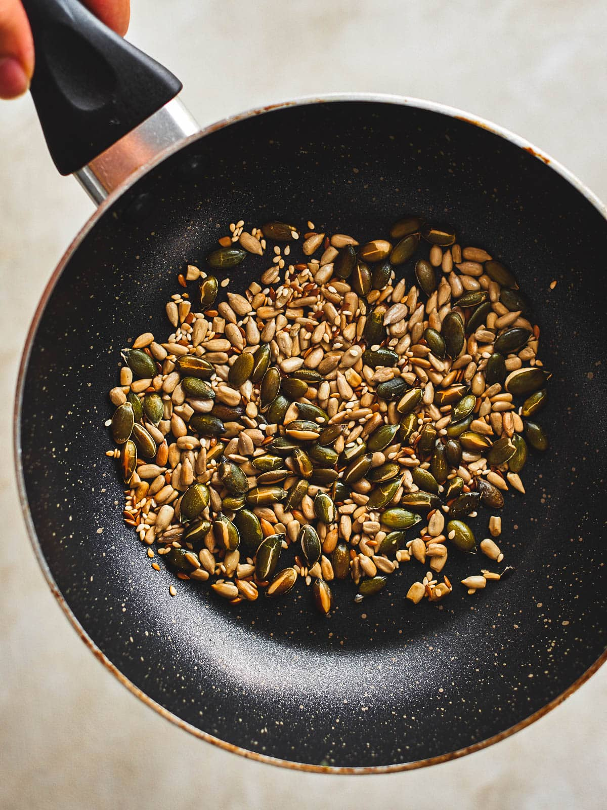 seeds toasting in a pan