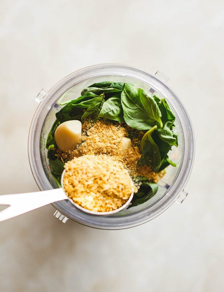 adding nutritional yeast to the blender