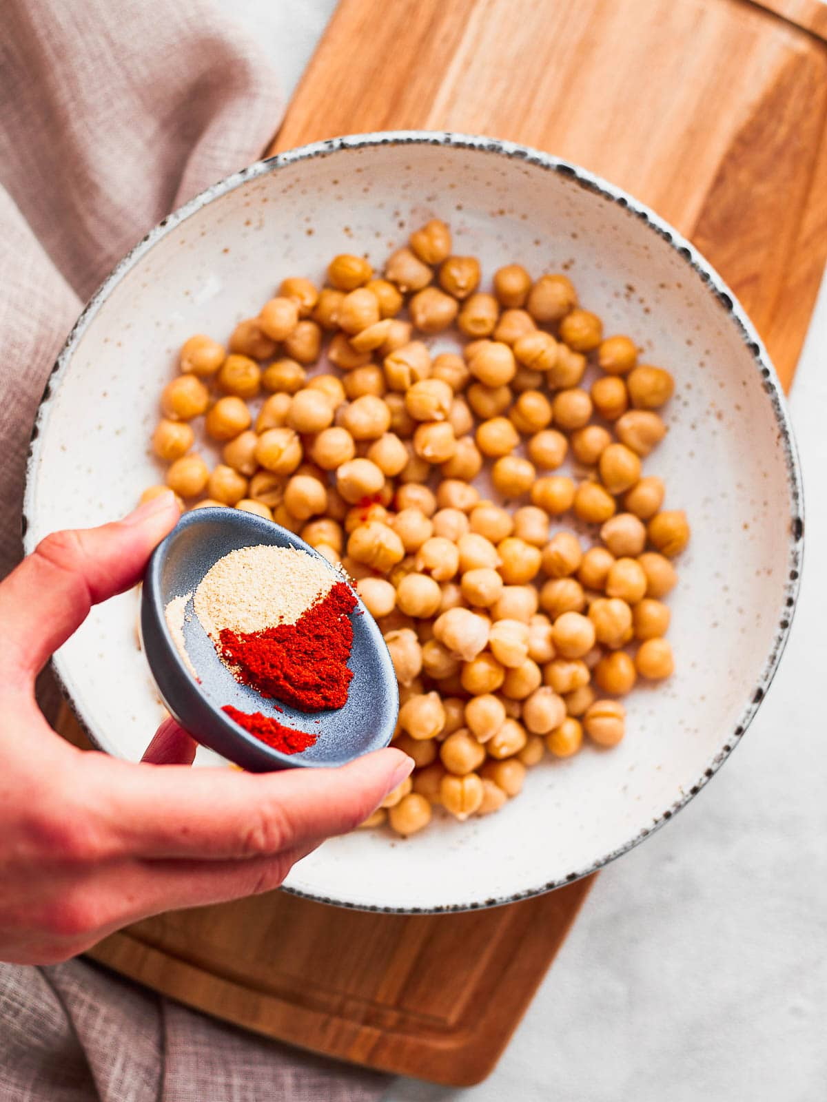 Adding spices to the chickpeas