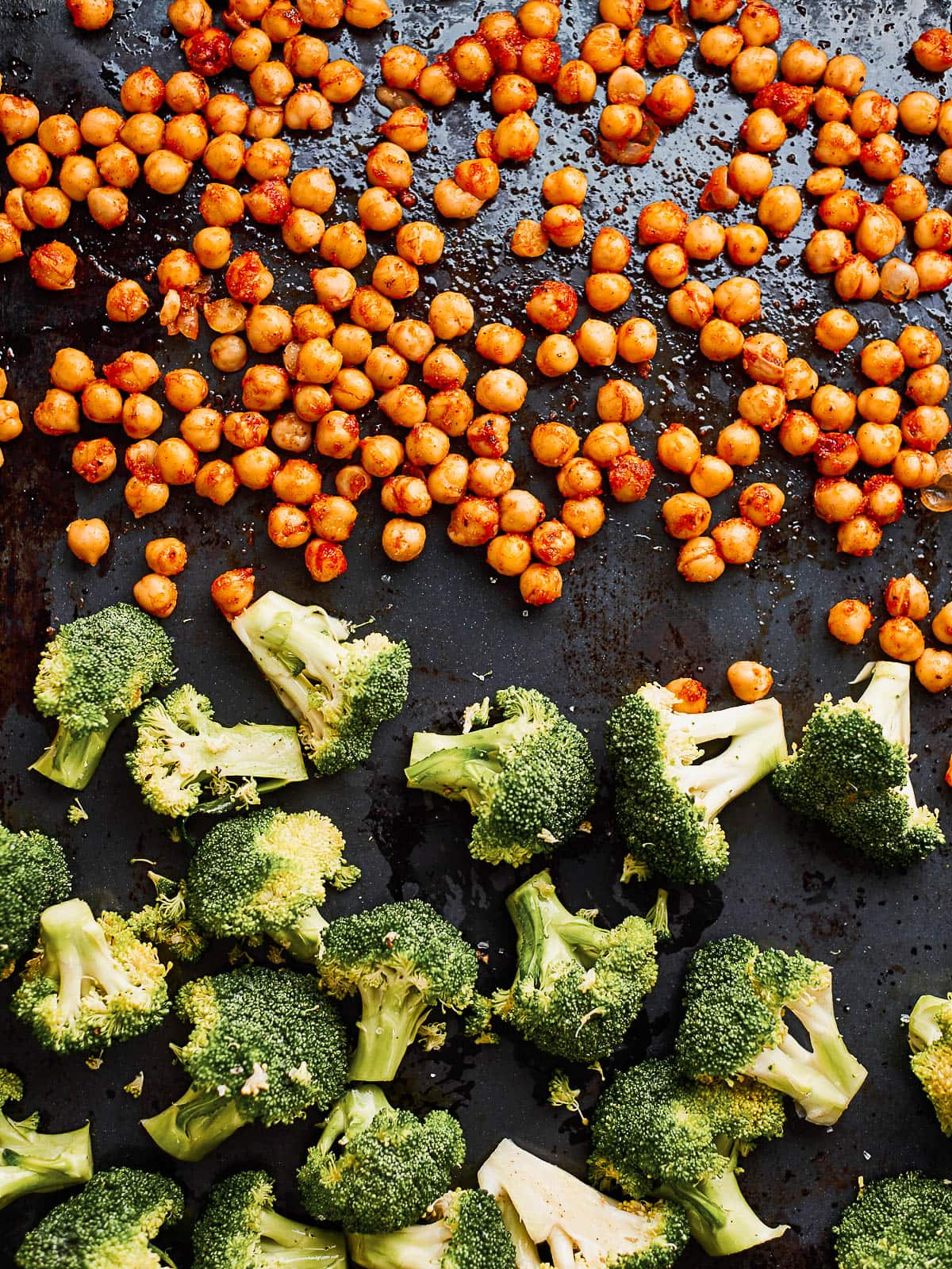 Broccoli and chickpeas on a baking sheet