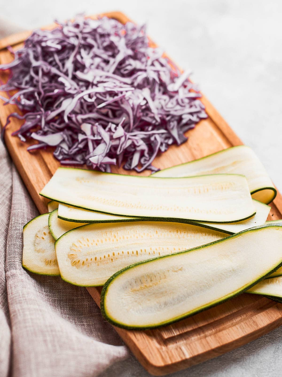 Sliced zucchini and cabbage ready to eat